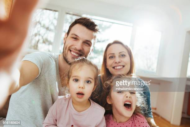 family giggling - family with two children stock photos and pictures