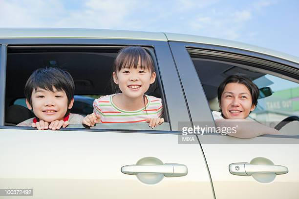 family going for a drive - 姉妹 ストックフォトと画像