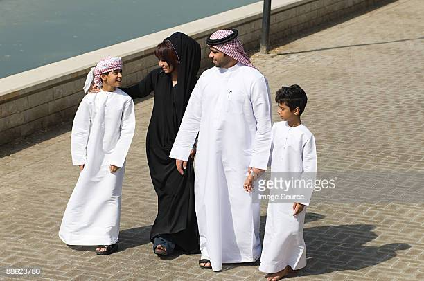 a family going for a walk - uae heritage stock photos and pictures