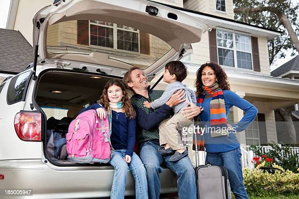 Family going on road trip with car and luggage