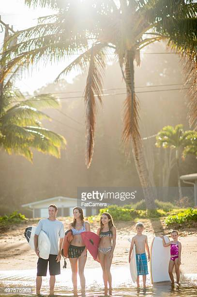 Family Going Surfing Together on Vacation