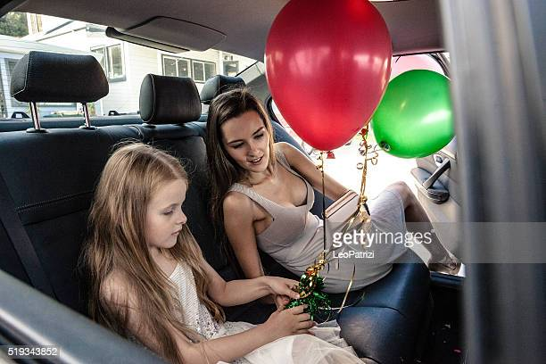 family going to celebrate a birthday party - birthday balloons stock photos and pictures