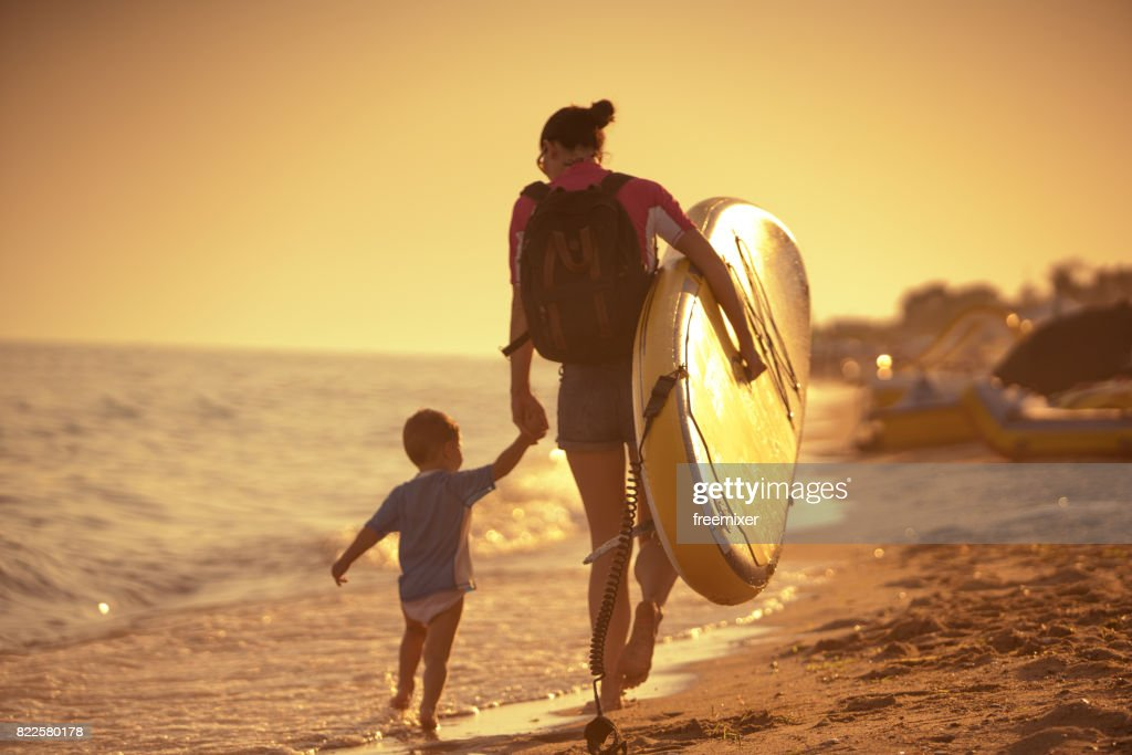 Family going to surf : Stock Photo