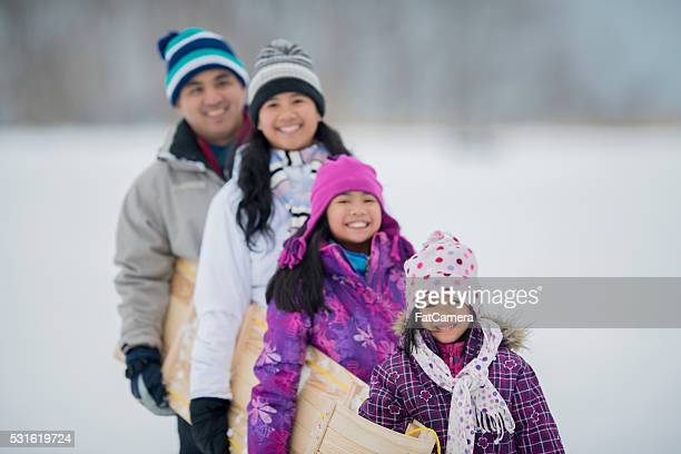 Family Going Tobogganing Together