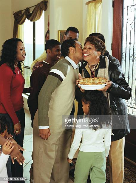 family greeting grandparents at door, smiling - thanksgiving dog stock photos and pictures