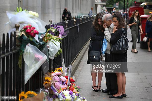 A family grieve as they stand next to a memorial to victims of the July 2005 bus bombing near Tavistock Square on July 7 2015 in London England Today...