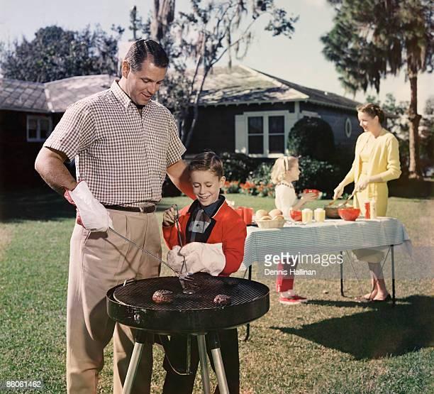 Family grilling in backyard