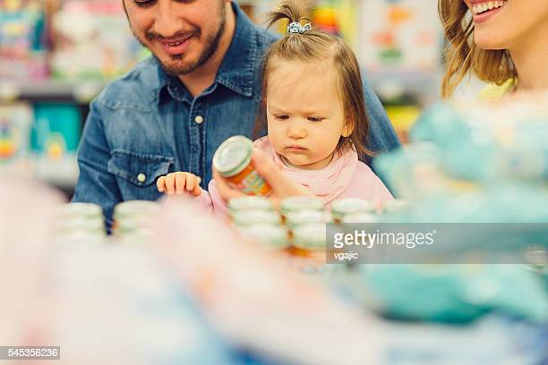 Family Groceries Shopping In Local Supermarket