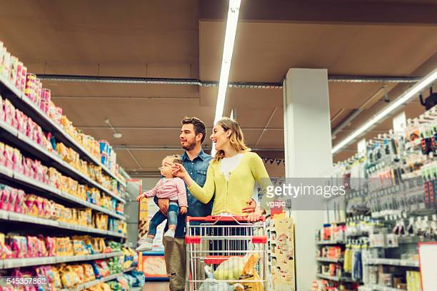 Family Groceries Shopping In Local Supermarket.