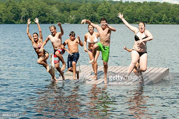 Family Group Jumping off Raft into Water