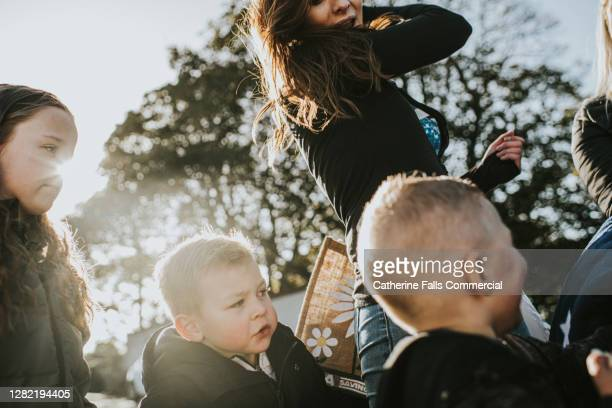 family group prepares themselves to go on an outdoor adventure - making stock pictures, royalty-free photos & images