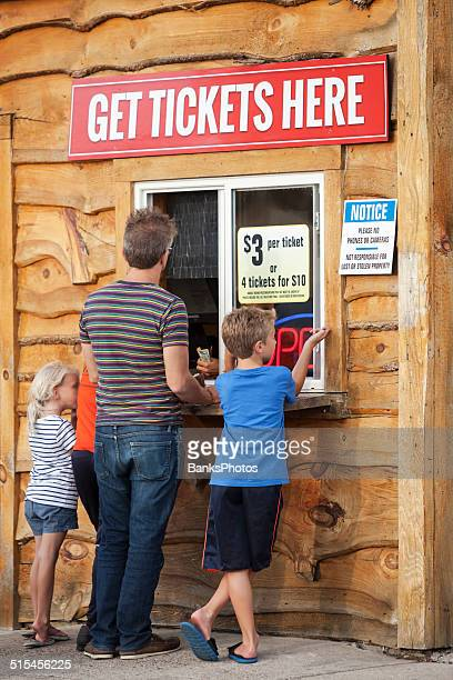 Family Group Purchasing Tickets at a Ticket Booth