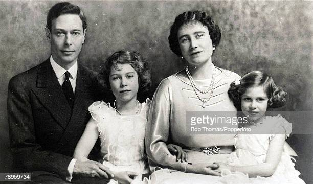 Family group shows King George VI and Queen Elizabeth with their daughters Princess Elizabeth and Princess Margaret rose.