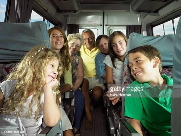 family group sitting in bus - hans neleman ストックフォトと画像