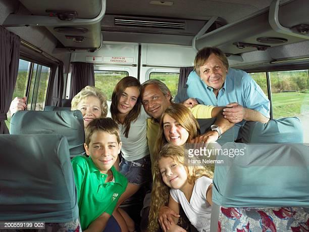 family group sitting in rear of bus, portrait - hans neleman ストックフォトと画像