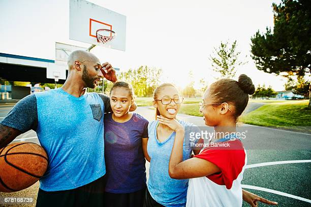 Family hanging out after basketball game
