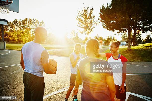 Family hanging out after playing basketball