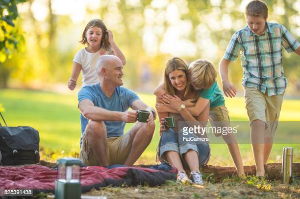 family hangout at campsite - fat bald men stock pictures, royalty-free photos & images