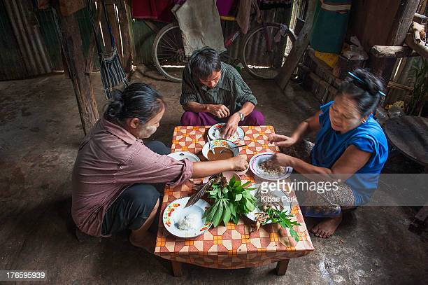 Family has breakfast at their home inside the Mae La refugee camp in Mae Sot near the Thai and Myanmar border on May 24, 2012. More than 89,000...