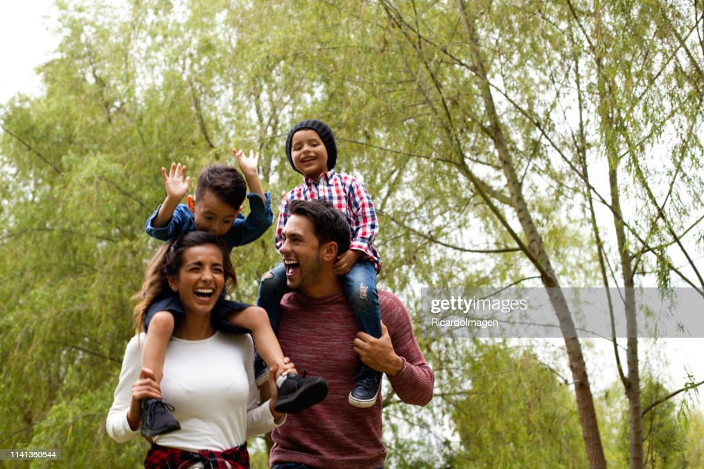 Family has fun playing in the field : Stock Photo