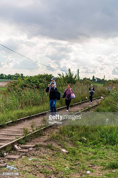 family has started the walk to Hungary along the train tracks on September 6 2015 Serbian and Hungarian border Ulrik Pedersen/NurPhoto