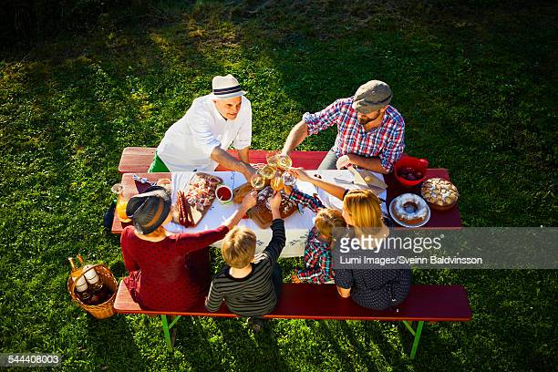 Family having a picnic in the garden, Munich, Bavaria, Germany