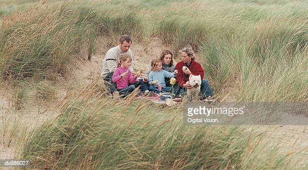 Family Having a Picnic With Their West Highland Terrier