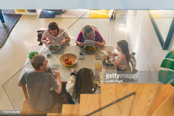 family having a roast dinner around the table - five people stock pictures, royalty-free photos & images
