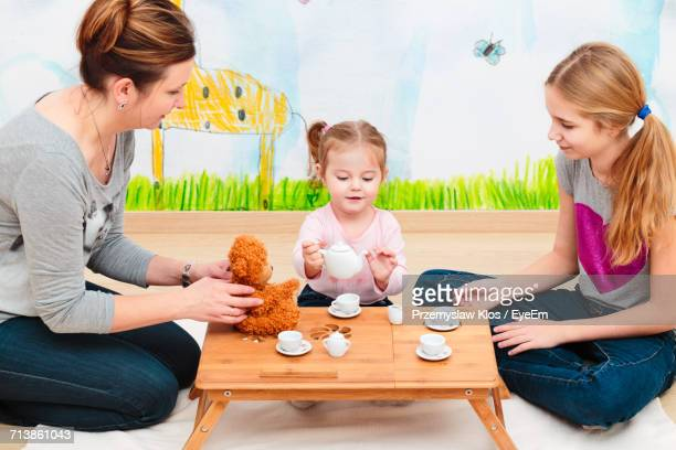 Family Having Baby Tea Party
