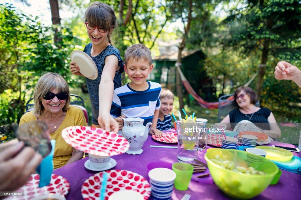 Family having barbecue in the garden : Stock Photo