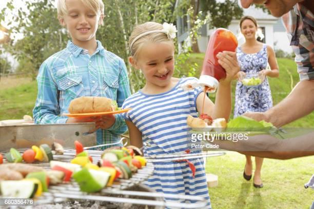 Family having BBQ in garden