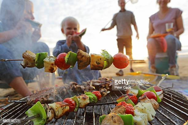 family having bbq on beach - picnic stock pictures, royalty-free photos & images