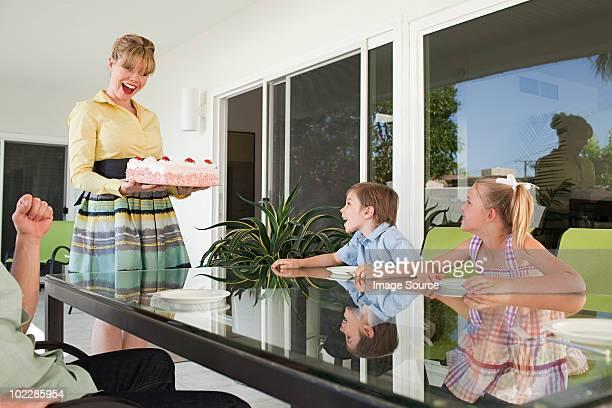 Family having birthday cake