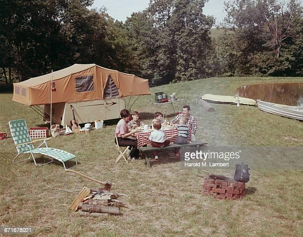Family Having Breakfast At Picnic In Park