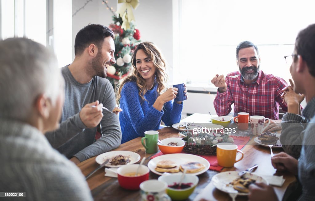 Family having breakfast on Christmas morning. : Stock Photo