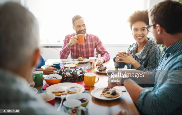 family having breakfast on christmas morning. - african american family dinner stock photos and pictures