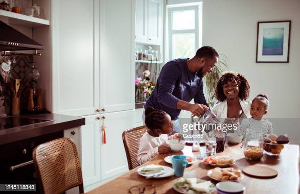 family having breakfast - food and drink stock pictures, royalty-free photos & images