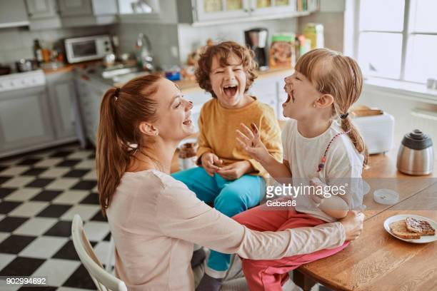 family having breakfast - family with two children stock photos and pictures