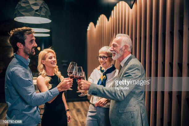 family having celebratory toast together - high society stock pictures, royalty-free photos & images