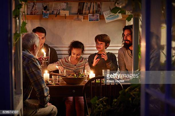 family having cozy dinner en garden house - ディナー ストックフォトと画像