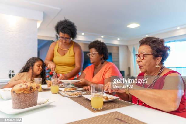 family having dinner at home - fat granny stock pictures, royalty-free photos & images
