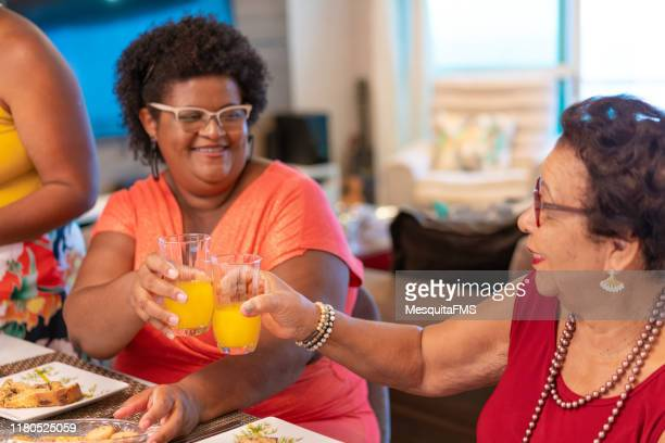 family having dinner at home - chubby granny stock pictures, royalty-free photos & images