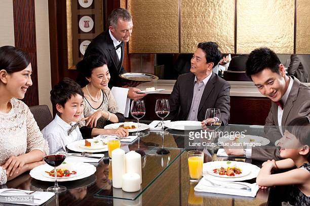 Family having dinner in a luxurious dinning room