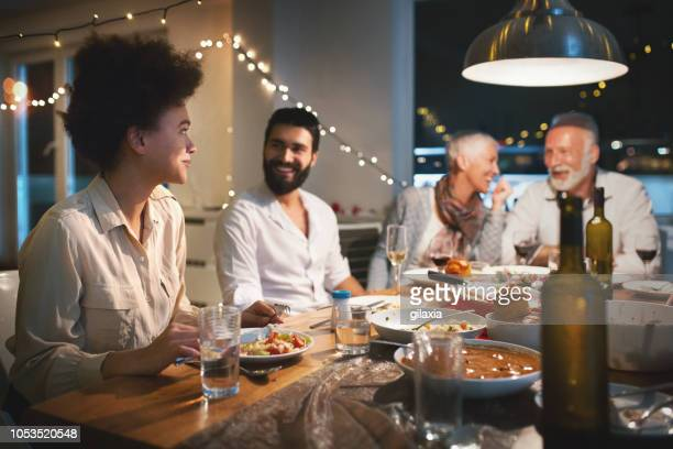 family having dinner on christmas eve. - mother in law stock pictures, royalty-free photos & images