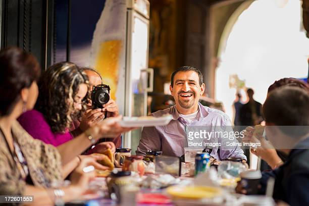 family having dinner together at table - dining stock pictures, royalty-free photos & images