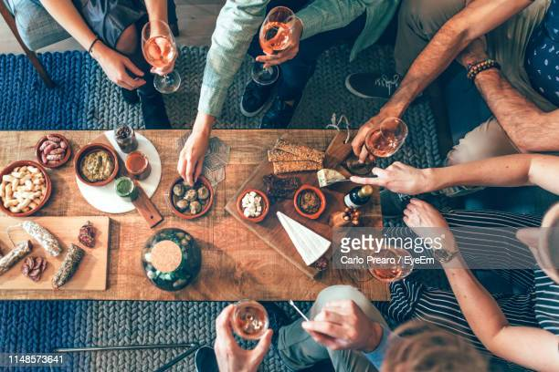 family having food and drink at restaurant - appetizer stock pictures, royalty-free photos & images