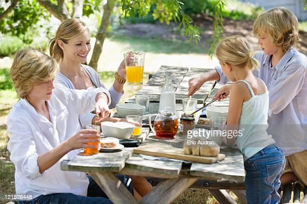 Family having food at front or back yard
