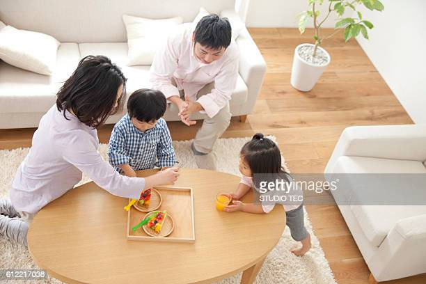 Family having food in living room