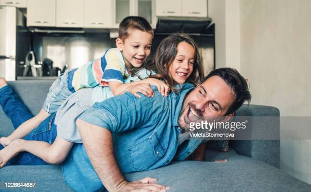 family having fun at home. - fathers day stock pictures, royalty-free photos & images