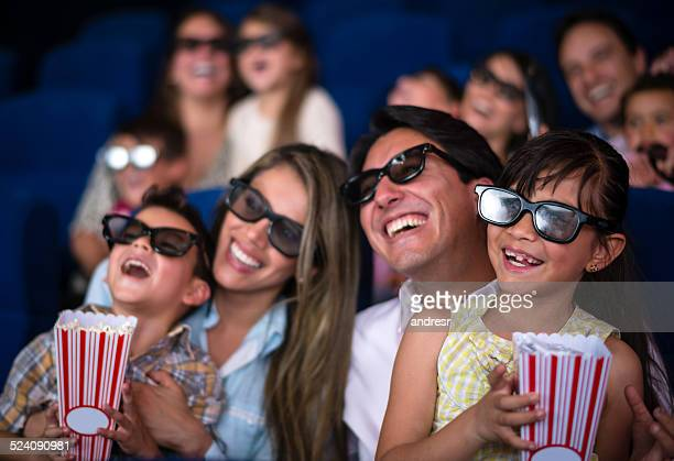 family having fun at the cinema - 3d mom son stock photos and pictures